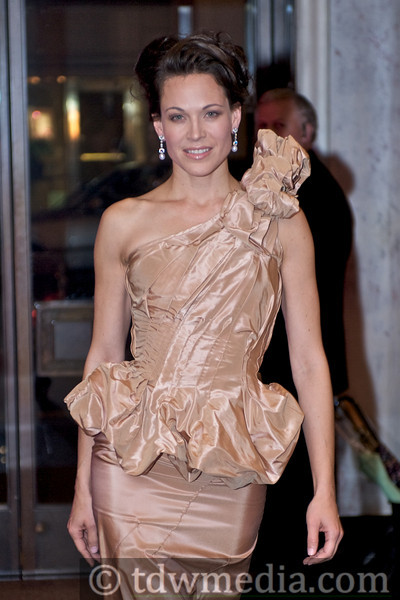 Sherri Siegel in a nude silk top and skirt