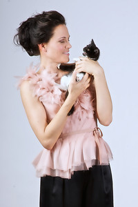 Sherri Siegel in a blush silk organza top with hand-sewn flower detail and black satin palazzo pants.