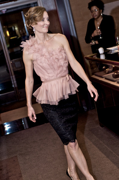 Ruth Krumbhaar in a blush silk organza top with hand-sewn flower detail and black French lace skirt