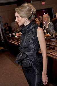 Nikki Haramoglis in a silk top with detachable cowl and matching pencil skirt
