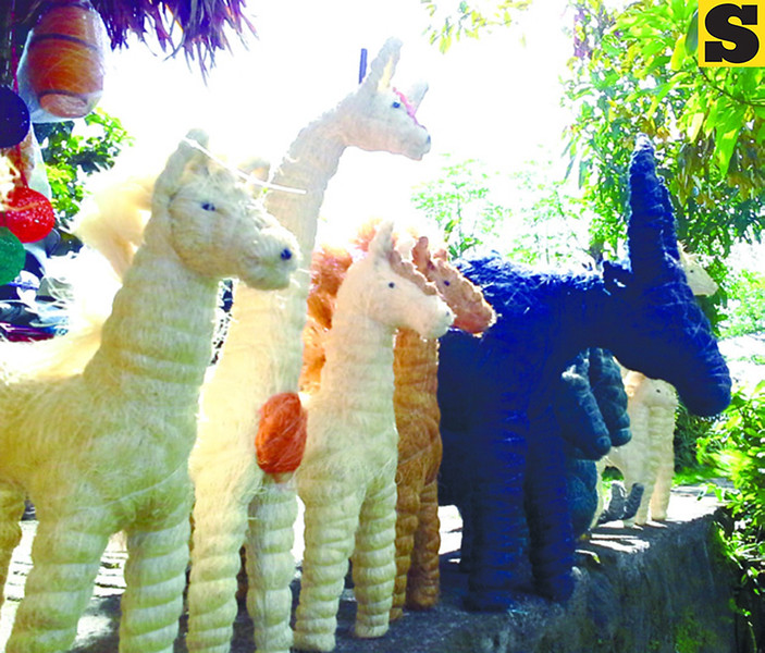 Animal figurines made of straw sold at one of the shops in the Cagsawa Ruins Park in Daraga, Albay. (Noel S. Villaflor photo)
