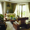 The formal living room with antique jars and wooden furnitures.