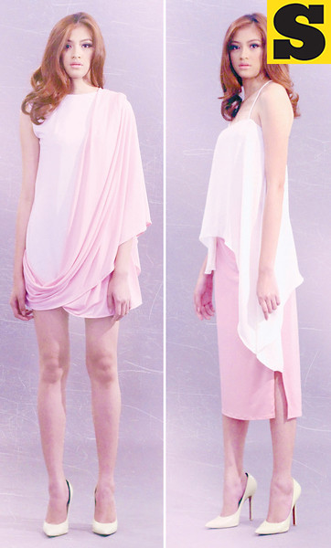 CHIC SHAPE. Asymmetric spaghetti-strap blouse paired with a light pink midi skirt.