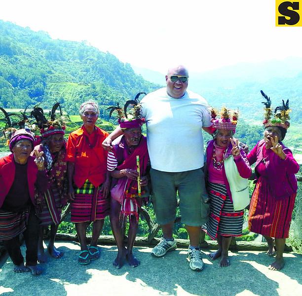 """Road tripper Jethro Estimo joins tribal elders for a """"wacky"""" shot. (Photo by Noel Villaflor of Sun.Star Cebu)"""