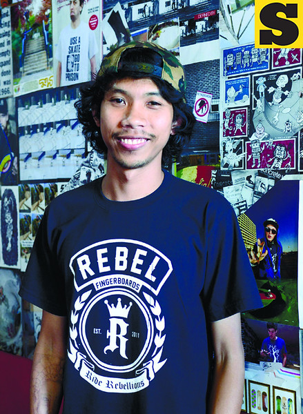 Ervi Jann V. Pescador, 24, created Rebel Fingerboards in June 2011 not just as a business but as voice for the young skateboarding flock. (Photo by Ruel Rosello of Sun.Star Cebu)