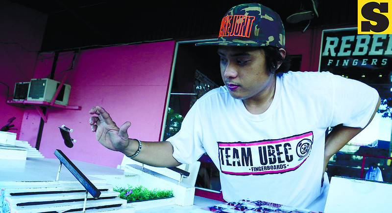 Rebel Fingerboards official rider Christopher Retuya taking care of fingerboard maneuvers, which are more or less similar with that of its mainstream counterpart, skateboarding. (Photo by Ruel Rosello of Sun.Star Cebu)