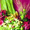 The cornucopia, or the symbol of abundance, is what designer Joseph Ursal of Fleur de Liz flower shop calls this arrangement, set up not at the usual center, but rather at the end of the table.  <br /> <br /> A show-stopper, it puts the season's flowers, poinsettias, in abundant display. <br /> <br /> Although here you can freely set up whatever food stuff you want, Joseph chose French bread and apples (arranged in wicker baskets) for this purpose. For accents, he uses twigs called shapu. Well, you can always use the apples as your candle holders!