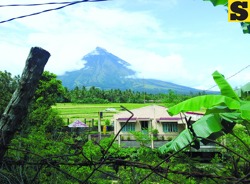 View of elusive Mayon Volcano from the side of the road. (Noel S. Villaflor photo)