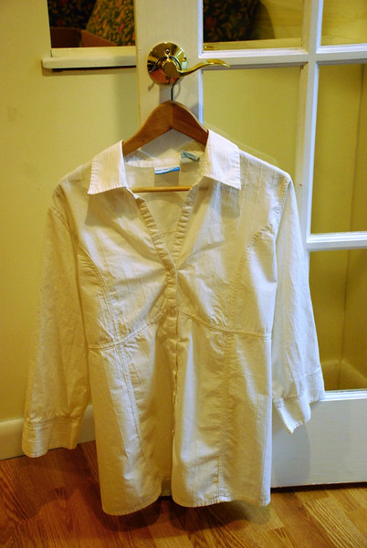 White Button-down. Has empire waist and ties in the back.
