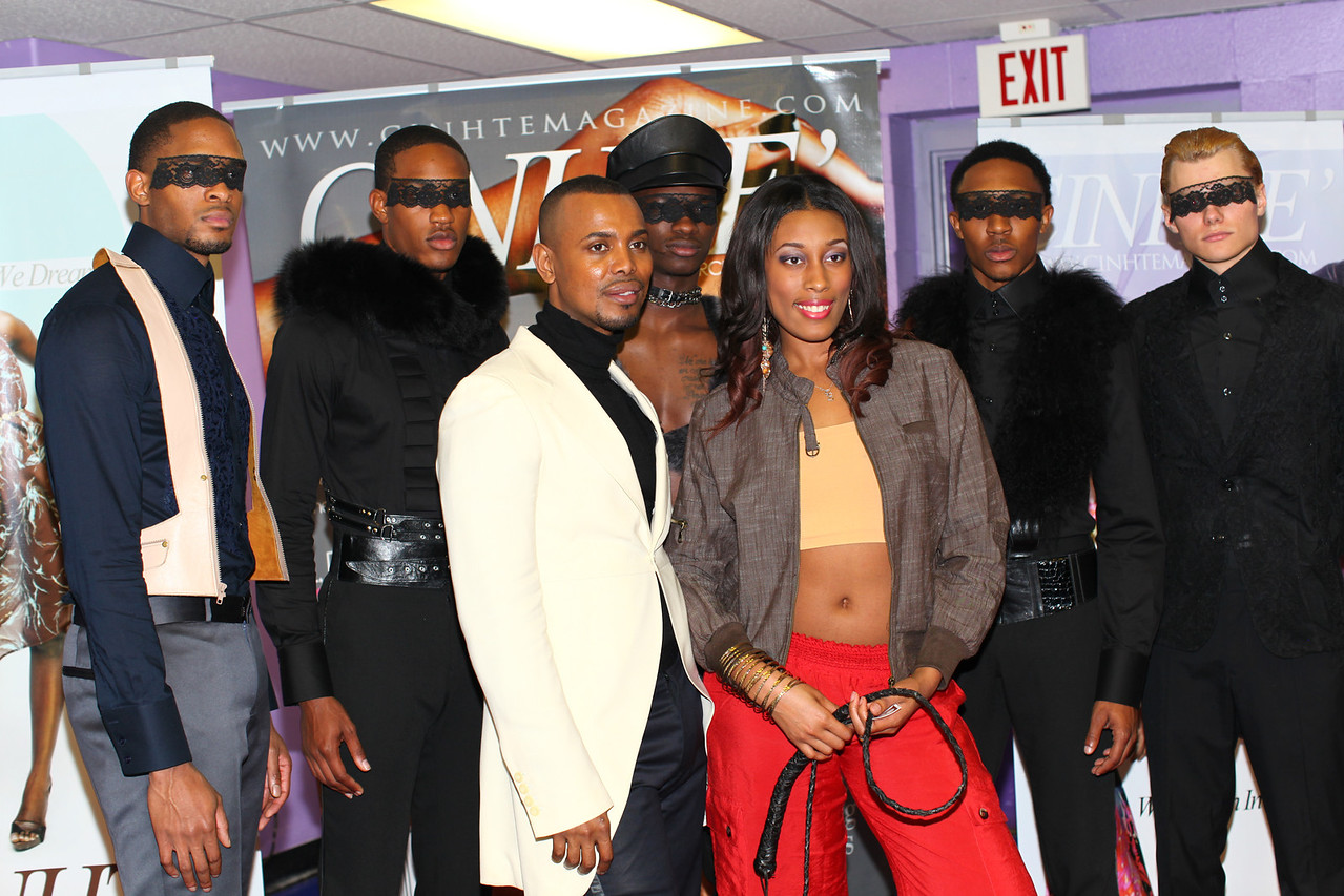 International designer Edwing D'Angelo (front L) poses with some of his models after the show. His creations were simply fabulous!!!