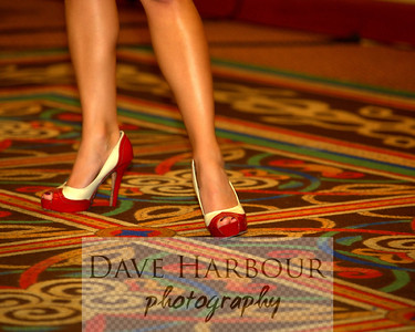 Red and White High Heeled Shoes on multi-colored carpet.