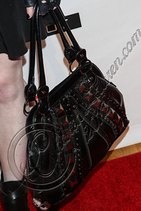 NEW YORK, NY - SEPTEMBER 10:  Musician Madame Mayhem (purse detail) attends Abbey Dawn By Avril Lavigne Spring 2013 at the Metropolitan Pavilion on September 10, 2012 in New York City.  (Photo by Chelsea Lauren/Getty Images)