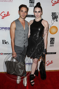 NEW YORK, NY - SEPTEMBER 10:  Billboard fashion editor Gregory Dellicarpini Jr (L) and musician Madame Mayhem attend Abbey Dawn By Avril Lavigne Spring 2013 at the Metropolitan Pavilion on September 10, 2012 in New York City.  (Photo by Chelsea Lauren/Getty Images)