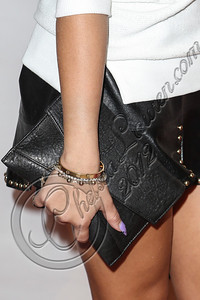 NEW YORK, NY - SEPTEMBER 10:  Actress / singer Adrienne Bailon (clutch detail) attends Abbey Dawn By Avril Lavigne Spring 2013 at the Metropolitan Pavilion on September 10, 2012 in New York City.  (Photo by Chelsea Lauren/Getty Images)