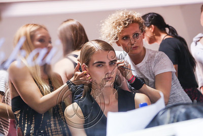 NEW YORK, NY - SEPTEMBER 08:  Hairstylist Cosma De Marinis (R) prepares a model backstage at Altuzarra Spring 2013 at Industria Superstudio on September 8, 2012 in New York City.  (Photo by Chelsea Lauren/Getty Images)