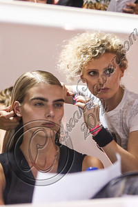 NEW YORK, NY - SEPTEMBER 08:  Hairstylist Cosma De Marinis prepares a model backstage at Altuzarra Spring 2013 at Industria Superstudio on September 8, 2012 in New York City.  (Photo by Chelsea Lauren/Getty Images)