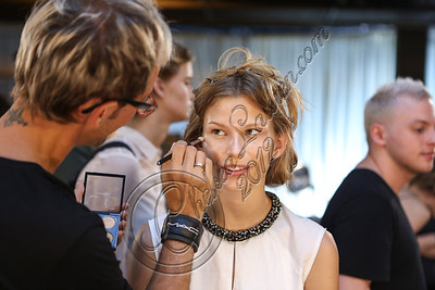 NEW YORK, NY - SEPTEMBER 08:  A model is prepared backstage at Edun Spring 2013 at Skylight Studios at Moynihan Station on September 8, 2012 in New York City.  (Photo by Chelsea Lauren/Getty Images)