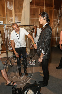 NEW YORK, NY - SEPTEMBER 13:  Designer Ricardo Seco (L) prepares a model backstage at the Ricardo Seco spring 2013 fashion show during Mercedes-Benz Fashion Week>at Pier 57 on September 13, 2012 in New York City.  (Photo by Chelsea Lauren/Getty Images)