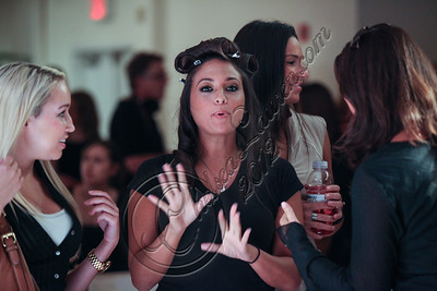 NEW YORK, NY - SEPTEMBER 10:  Designer Sammi Giancola watches rehearsals at Sammi Sweetheart Spring 2013 at the Metropolitan Pavilion on September 10, 2012 in New York City.  (Photo by Chelsea Lauren/Getty Images)