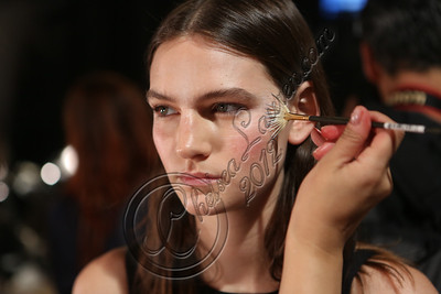 NEW YORK, NY - SEPTEMBER 07:  A model is prepped backstage at the Tess Giberson spring 2013 fashion show during Mercedes-Benz Fashion Week at Eyebeam on September 7, 2012 in New York City.  (Photo by Chelsea Lauren/Getty Images)