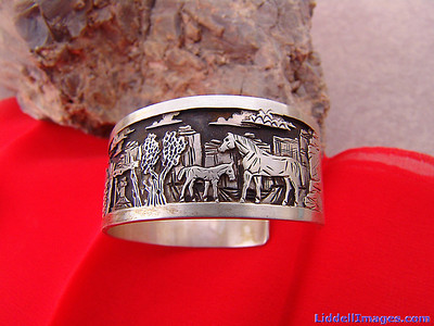 "(18) Three ply storyteller sterling silver bracelet ""The Lost Sheep"" by Navajo Cody Hunter. (Left Side)"