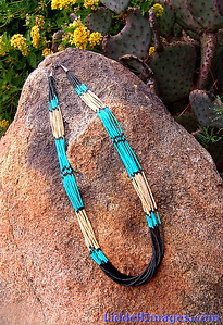 (7) Ten strand turquoise melon shell and jet heishi necklace - 26""
