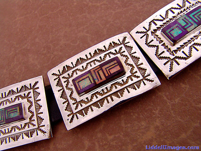 "(12) Eleven piece sterling silver, opal and sugilite concho belt - 32"" by Navajo Harrison Jim.  Sugilite is a rich royal blue mineral widely enjoyed as an ornamental stone. Although massive sugilite samples are opaque, crystals are usually transparent to translucent. Sugilite is a member of the sugilite group and together with hauyne, nosean and lazurite is a common constituent of lapis lazuli."