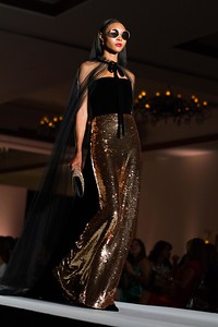 Monique Lhuillier strapless column gown with velvet bodice and rose gold sequin skirt