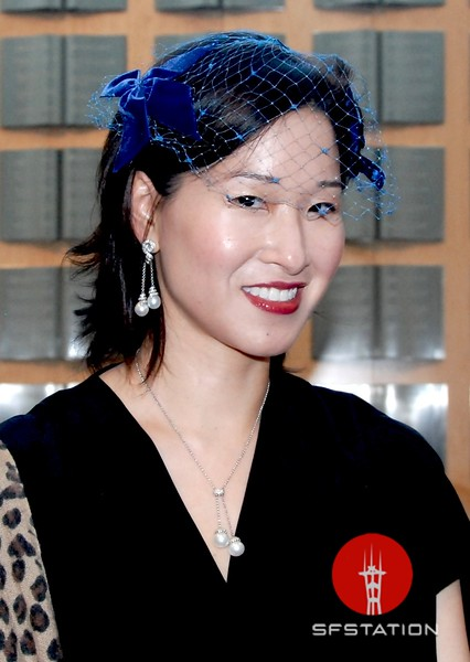 Photo by Lily Ko<br /> <br /> In This Scene: Kim Dodd, in a vintage blue veil with velvet bows. Dodd collects eccentric hats and said this was one of her more subtle pieces. The royal blue looks lovely with her red lips and flawless skin.