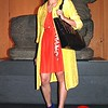 Photo by Lily Ko<br /> <br /> In This Scene: Grace Chen is all about color and wears it with a smile. Chen, a freelance fashion writer, is wearing a beautiful vintage coat from American Rag, pleated chiffon dress from H&M dress, and strappy blue Zara pumps. What looks like a headband is actually a braid across the crown of her head--gorgeous!