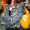 Photo by Lily Ko<br /> <br /> In This Scene: A closer look at Susie Sutton's black & white Etro coat. The antique pattern is just gorgeous and her Kate Spade bag brings out the yellow piping quite nicely. Sutton's necklace is made of 70-year-old coral and was a gift.