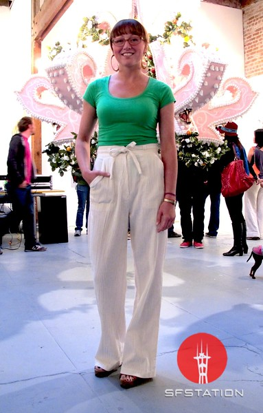 Photo by Lily Ko<br /> <br /> In This Scene:  Brynda Glazier, in front of the massive Scott Hove cake chandelier at the 941Geary gallery opening. There's something so great about a clean, simple, colorful outfit and Glazier is wearing just that. Her pants a vintage from the Haight. Her platforms are also vintage from one of my favorite vintage shops in Seattle, Red Light.