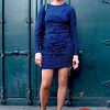 Photo by Lily Ko<br /> <br /> In This Scene:  Hair stylist, Blair Ellen Everett in a Nicole Miller dress and Via Spiga shoes. I love the simple stripes that work so well with the horizontal fabric tucks down the center of the dress. I also think there's something sexy about a long sleeved mini dress--it's not your typical combination.