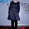Photo by Lily Ko<br /> <br /> In This Scene:  Casey Schumacher in an adorable navy coat by Betsy Johnson. I love this coat with the scallop edge and purple buttons! Schumacher's grey leather cut-out lace-ups are from Chelsea Crew. Her grey scarf, from Urban Outfitters, matches perfectly.