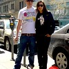 Photo by Lily Ko<br /> <br /> In This Scene: Bernd Sadok and Saskia Ehlen, of Berlin, in line for brunch at Brenda's. Sadok is wearing a Stussy shirt and used an old shoelace to make a strap for his camera. I Iike how he tucked one pant leg into his sneaker to show off his yellow and white Nikes.  Ehlen is wearing an astronaut print tee from mural artist Victor Ash. All pieces were purchased in Berlin.