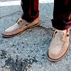 Photo by Lily Ko<br /> <br /> In This Scene:  Mike Lustbader loosens up his look with these laceless John Varvatos suede boat shoes.