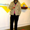 Photo by Lily Ko<br /> <br /> In This Scene: Tony Sison at the Micke Tong art opening at Public Barber Salon. Sison, a DJ for the Beauty Bar, is wearing a Top Man cropped trench that hits just below the waist. This length is ideal for men with less height. Sison also shows how to wear bright colors subtly. His magenta Helmut Lang sweater is bold, but only peeks though, making you want to see more.