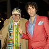 """Photo by Lily Ko <br /> <br /> In This Scene: Christian Jung with Adam Reed Rozan. Jung's sweater-jacket was custom made by Al's Attire. At first glance, you notice the colorful stripes, but when you look closer, you see all the great details. Get a load of the mixed stripes on the shawl collar and pockets. The keyhole button holes with contrast stitching are really lovely, too. The embroidery says """"Lebowski"""" and has two bowling pins, in reference to The Big Lebowski--fashion can be such cheeky fun."""