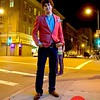 Photo by Lily Ko<br /> <br /> In This Scene: Adam Reed Rozan in a red herringbone Filippa K jacket. This is a very bold, very beautiful jacket. Here, Rozan, wore it casually with a pair of brown oxfords and blue jeans. The loosely folded pocket square is a classic piece that pulls everything together, while keeping the overall look relaxed.