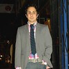 """Photo by Lily Ko<br /> <br /> In This Scene: Dan Caporale, drummer for B and Not B, looking snazzy in mixed stripes. His thrifted blazer is a grey pinstripe, while his tie features a navy diagonal stripe. His Gap shirt rounds it out with a nice check print. Caporale is showing some sexy sleeves, too. Your shirt should hit just below your wrist, and your jacket should be a 1/2"""" to 1"""" shorter. Here, it's particularly nice because he's wearing such a fun shirt."""