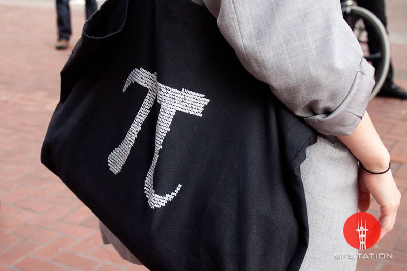 "Photo by Tessa Morris<br /> <br /> In this scene: One of Alexandra's best friends gave her this ""Pi"" purse. Her blazer is Yves Saint Laurent but was found at a thrift store."