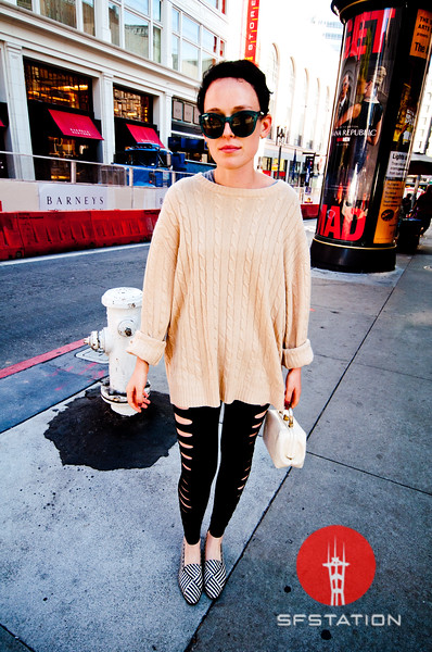 An oversized sweater goes perfect with her cut up leggings and cute lunch box shaped bag!<br /> <br /> Photo by Monica Hom