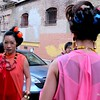 Photo by Lily Ko<br /> <br /> In This Scene:  Stephanie Ng (left) and Kristina Owyoung (right), getting ready for their photoshoot. Both models are wearing dresses  by Monique Zhang, Sally Bass jewelry and, yes, whiffle balls in their hair! The whiffle balls actually look pretty great as hair accessories--definitely a cool idea.