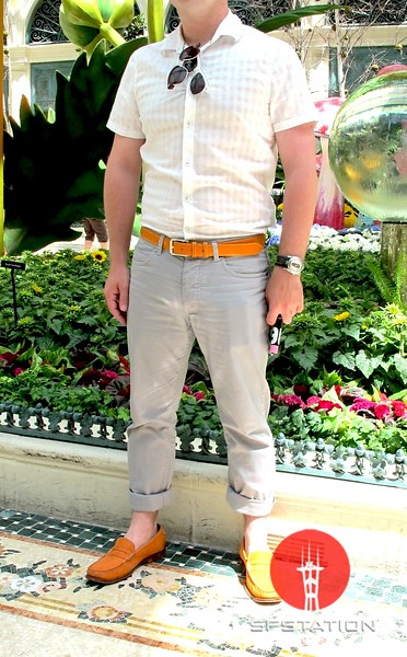 Photo by Lily Ko<br /> <br /> In This Scene:  D. S. in the flower gardens at The Bellagio. He is wearing a shirt and pants by H&M, orange leather belt by Longchamp, watch by D&G, and orange suede loafers by Cole Haan. I love the bright orange accessories against the soft gray and white--beautiful.