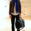 Photo by Lily Ko<br /> <br /> In This Scene:  Robert Alford in the entrance to the Fisher exhibit at SFMOMA. His boyfriend's royal blue scarf from Old Navy immediately caught my eye. That blue really pops and make this outfit. His hoodie is, appropriately, from Gap and jeans from Levis. Another detail you can't miss when looking at Alford is his gorgeous hair. Alford gets his wavy locks cut by Irene at Shear Delight.