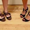 Photo by Lily Ko<br /> <br /> In This Scene:  Caitlin Moneypenny-Johnston (left) and Beth Cook (right) show two pretty ways to tie your laces. Johnston's flats remind me of kiddie tap shoes with the updated Mary Jane style shoes from Modcloth. Cook's open-toed Farylrobin heels feature a a great cut-out design and are just super cute shoes.