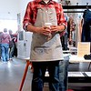 Photo by Lily Ko<br /> <br /> In This Scene:  Dan Conner, manager of the Levi's Workshops, in his workwear, of course. Conner is wearing a Levi's railroad stripped work apron, Levi's jeans and Converse Chuck Taylors.
