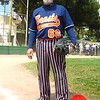 Photo by Lily Ko<br /> <br /> In This Scene:  Tim Birmingham putting some serious fashion on the field. Birmingham's plays in the SF Softball League on the Beasts of Bourbon. It takes a real softball pro to wear this snazzy of a uniform to a game. Birmingham is wearing a navy custom-printed jersey and nylon-poly-cotton white and orange striped pants by Boomah. And, naturally, he has the belt, custom hat, shoes, and of course glove to match. Birmingham's glove is a pretreated, black and gray leather first base mitt, of the SilverBack series by Rawlings, and he knows how to use it!
