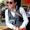 Photo by Lily Ko<br /> <br /> In This Scene:  Photographer Alex Greenburg, looking like a suave little Euro-tourist at Four Barrel coffee in the Mission. And that would be a hot little Lecia M6 around his neck.