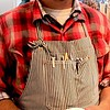Photo by Lily Ko<br /> <br /> In This Scene:  Dan Conner in layered plaids. I love this look! I like that his collar is tucked in, but still shows, while his sleeves are rolled over to also show both plaids. If his inner-collar was laid over his outer-collar it would be an entirely different look. It was also nice how Conner mixed up not only the color-schemes, but also the size and patterns of the plaids. I think it works best with the bolder plaid on top, like shown here. I'd be interested in seeing this in a girls look, too--maybe even with layered shirt-dresses!